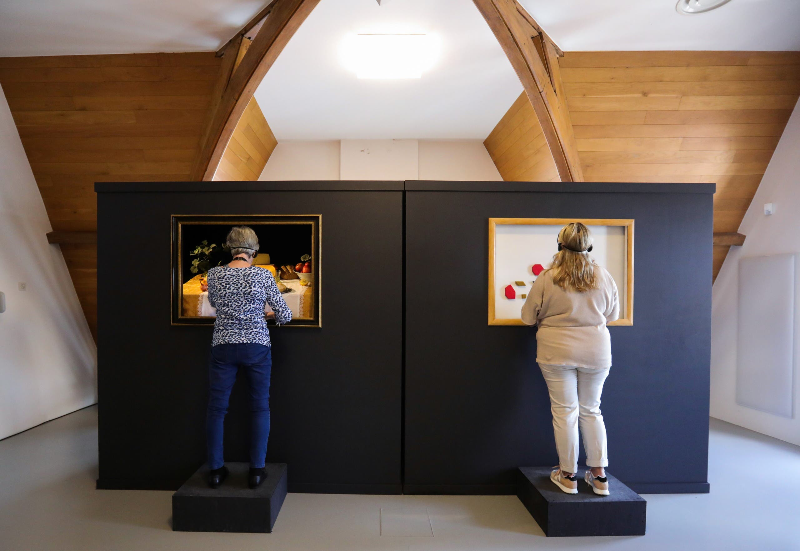 Visitors interact during the exhibition The Blind Spot by artist Jasper Udink ten Cate and experience designer Jeroen Prins, aimed for blind and visually impaired visitors to appreciate art by touching and smelling at Centraal Museum in Utrecht, Netherlands, August 14, 2021. Picture taken August 14, 2021. (Reuters)