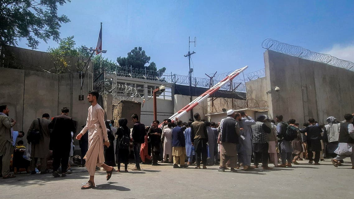 Afghan people gather outside the French embassy in Kabul on August 17, 2021 waiting to leave Afghanistan. (AFP)
