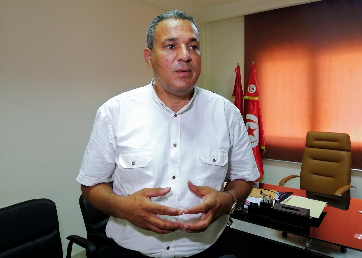 Mohamed Ali Boughdiri, deputy head of the UGTT union, attends an interview with Reuters in Tunis, Tunisia August 16, 2021. (Reuters)