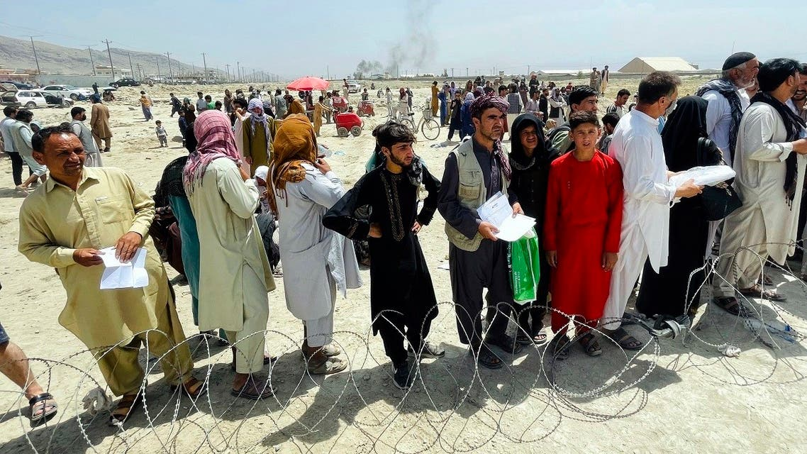Hundreds of people gather outside the international airport in Kabul, Afghanistan, on August 17, 2021. (AP)