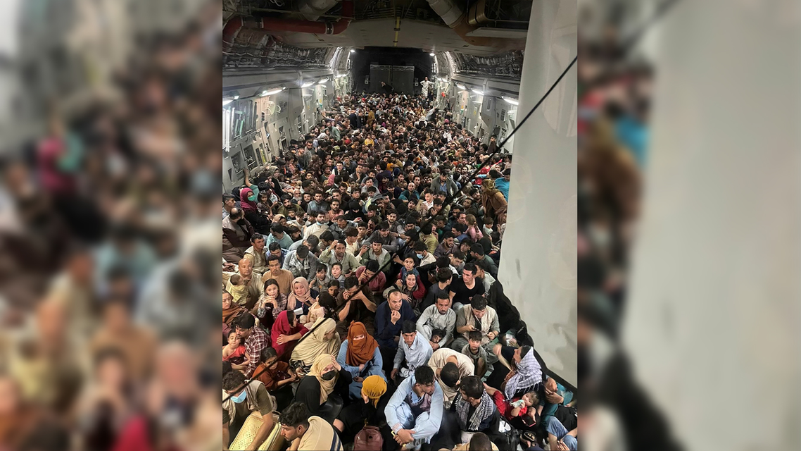 Evacuees crowd the interior of a US Air Force C-17 Globemaster III transport aircraft, carrying some 640 Afghans to Qatar from Kabul, Afghanistan August 15, 2021. (Reuters)