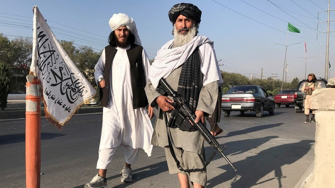 A Taliban fighter holding an M16 assault rifle stands outside the Interior Ministry in Kabul, Afghanistan, on August 16, 2021. (Reuters)