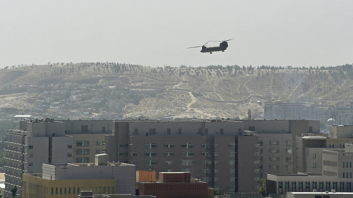 A US Chinook military helicopter flies above the US embassy in Kabul on August 15, 2021. (AFP)