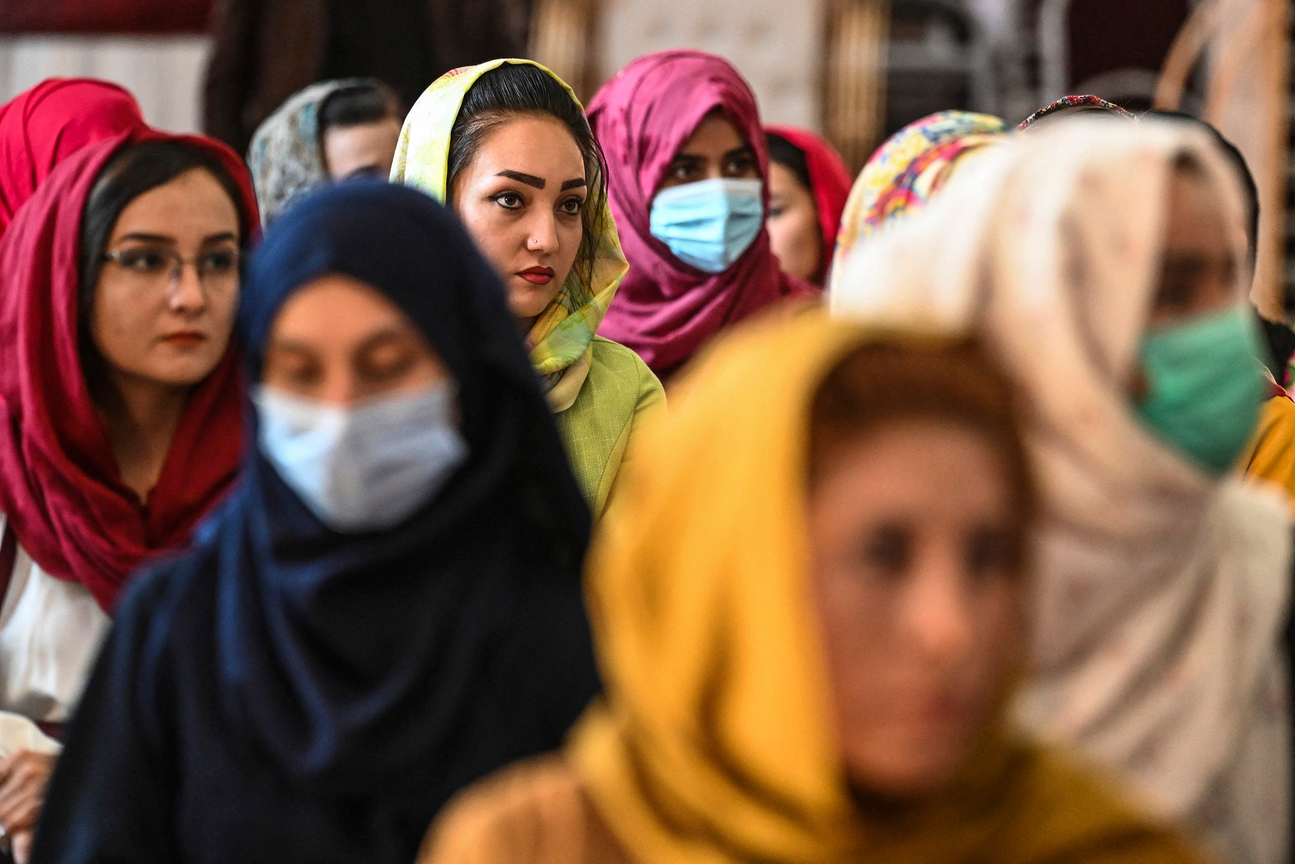 Afghan women take part in a gathering at a hall in Kabul on August 2, 2021 against the claimed human rights violations on women by the Taliban regime in Afghanistan. (Reuters)