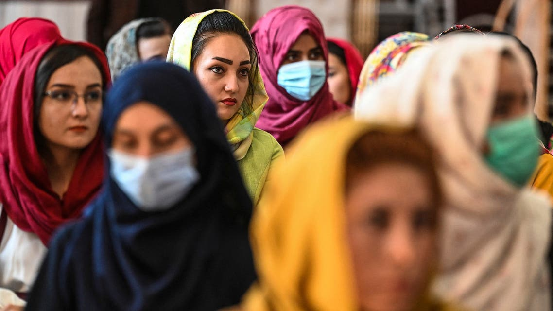 Afghan women take part in a gathering at a hall in Kabul on August 2, 2021 against the claimed human rights violations on women by the Taliban regime in Afghanistan.
