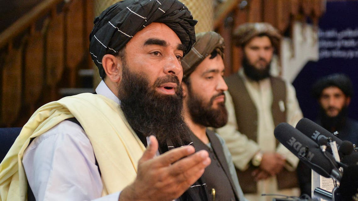 Taliban spokesperson Zabihullah Mujahid (L) gestures as he speaks during the first press conference in Kabul on August 17, 2021 following the Taliban stunning takeover of Afghanistan.
