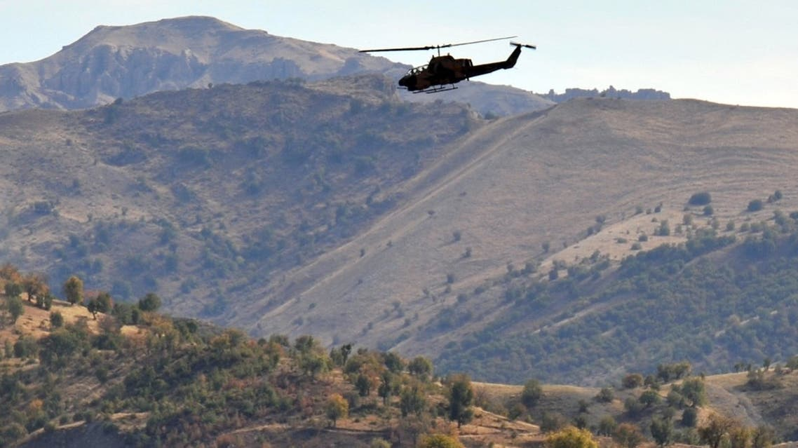 A Turkish military helicopter flies over a mountain in Yemisli, Hakkari province near the Iraqi border in southeastern Turkey, on October 22, 2011. (AFP/Mustafa Ozer)
