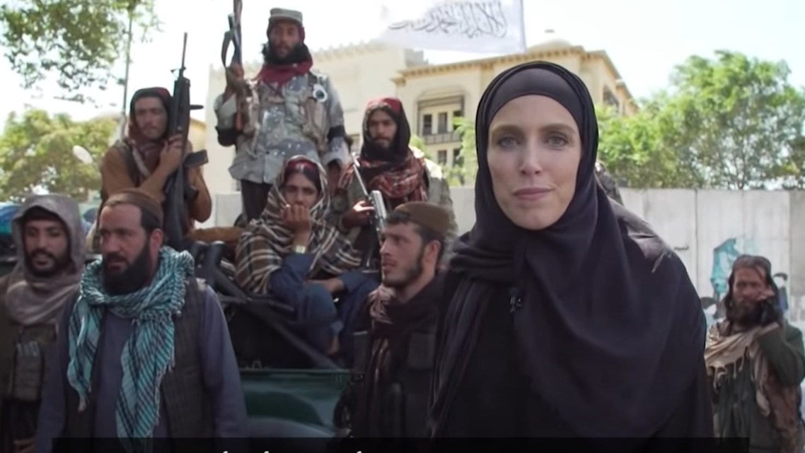 US female Reporter wore Hijab front of Taliban
