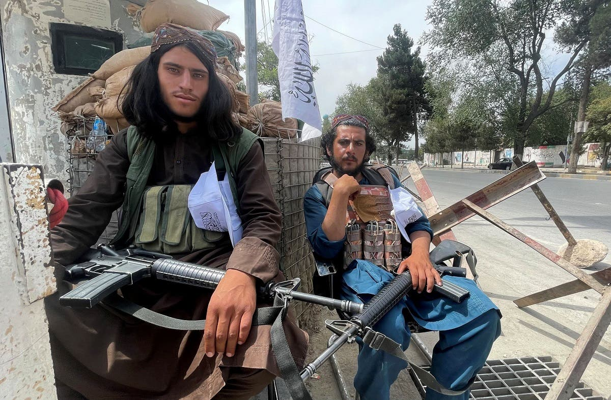 Members of Taliban forces sit at a checkpost in Kabul, Afghanistan, on August 17, 2021. (Reuters)