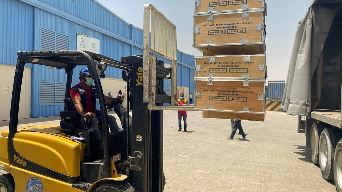 A forklift driver loads the medical supplies which will be sent to India at the International Humanitarian City in Dubai, United Arab Emirates, May 9, 2021. (Reuters)