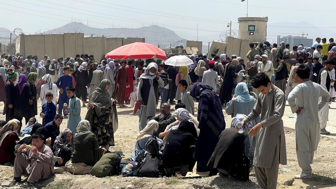 People wait outside Hamid Karzai International Airport in Kabul, Afghanistan August 17, 2021. REUTERS/Stringer NO RESALES. NO ARCHIVES