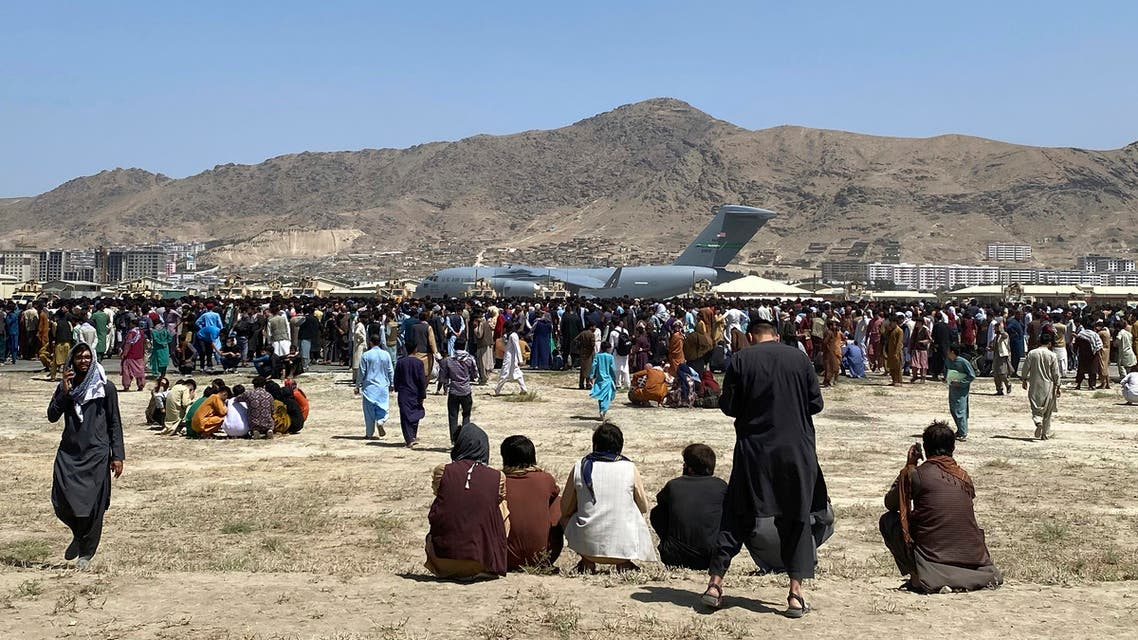 Hundreds of people gather near a U.S. Air Force C-17 transport plane at a perimeter at the international airport in Kabul, Afghanistan, Monday, Aug. 16, 2021. (AP)