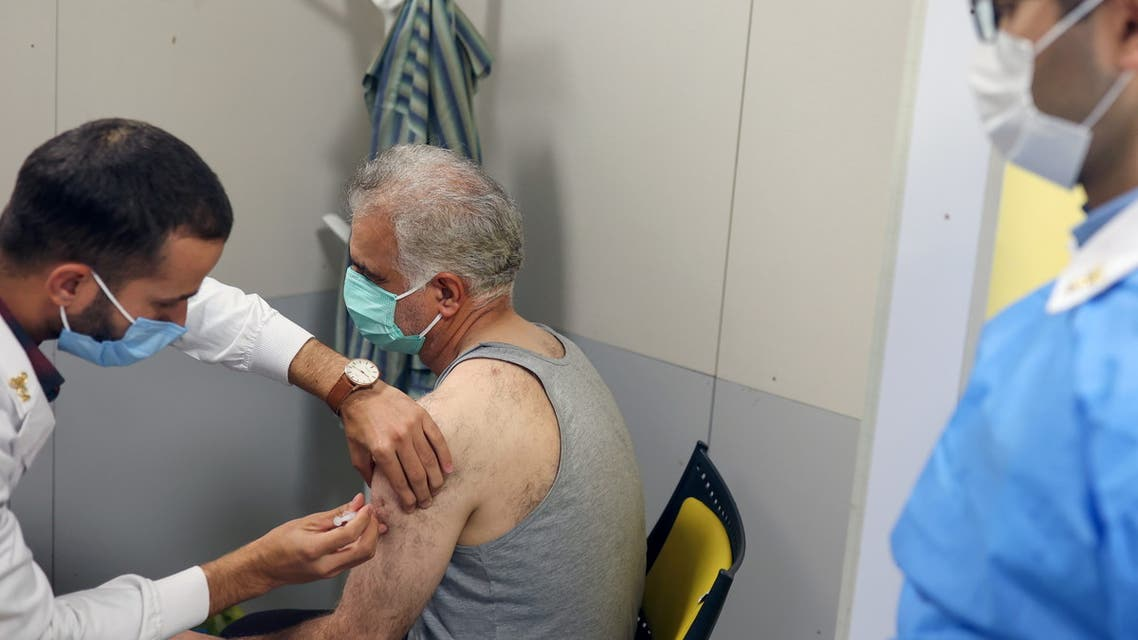 An Iranian man receives a dose of a vaccine against the coronavirus disease (COVID-19) as cases spike, in a vaccination center in Tehran, Iran August 9, 2021. Picture taken August 9, 2021. Majid Asgaripour/WANA (West Asia News Agency) via REUTERS ATTENTION EDITORS - THIS IMAGE HAS BEEN SUPPLIED BY A THIRD PARTY.