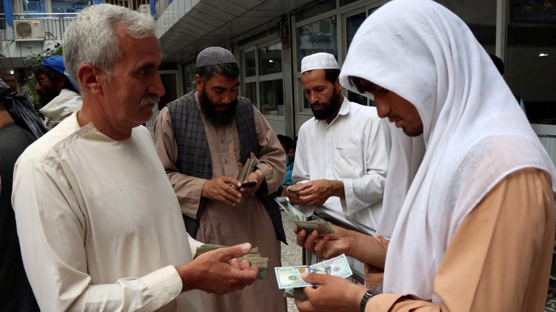 Afghan money changers gather to deal with foreign currency at a money change market in Herat province, Afghanistan. (File photo: Reuters)