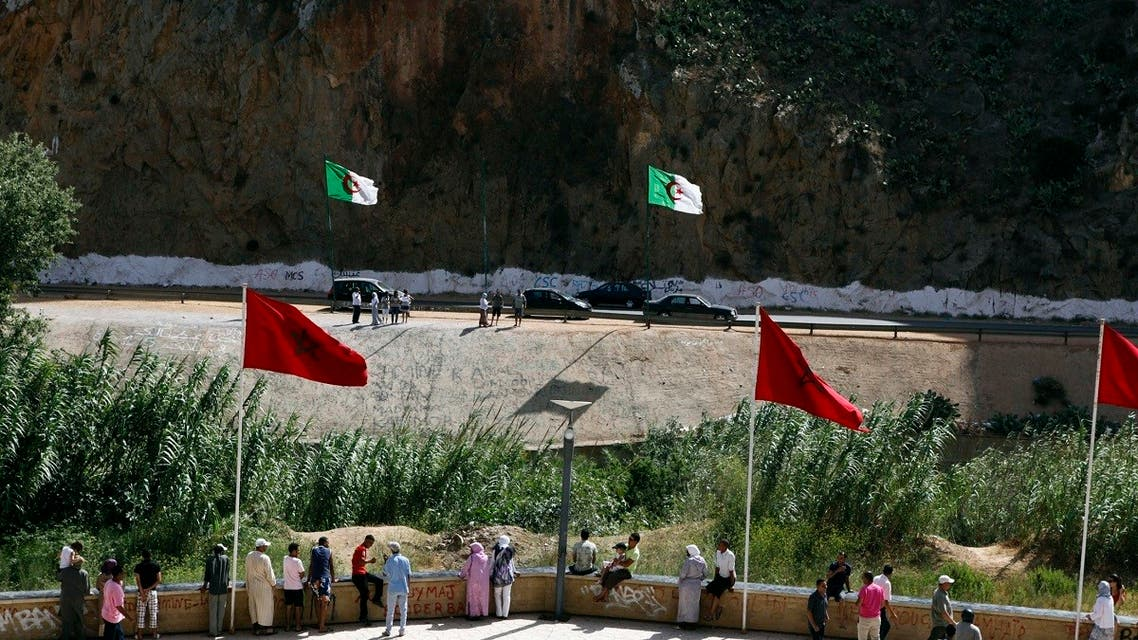 People stand near a border post on the Algerian side of the Morocco-Algeria border in the north east of Morocco. (Reuters)