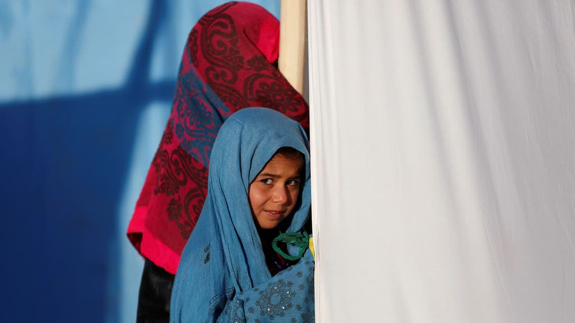 An internally displaced Afghan girl stands outside her tent at a refugee camp in Herat province, Afghanistan October 14, 2018. (File photo: Reuters)