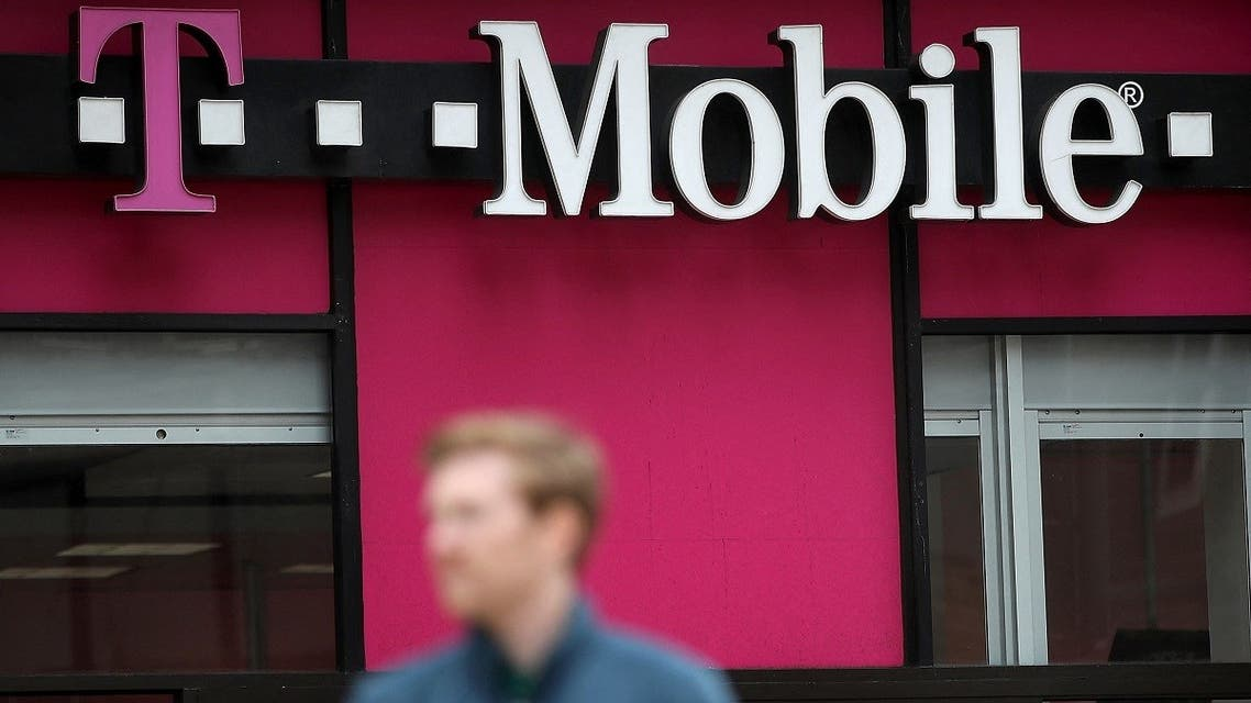 A pedestrian walks by a T-Mobile store in San Francisco, California. (AFP)