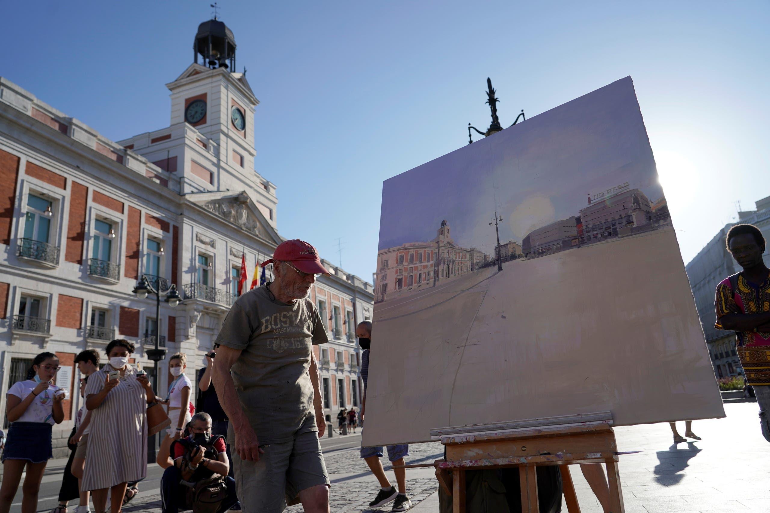 Spanish artist Antonio Lopez prepares to paint the famous Puerta del Sol square in Madrid, Spain, August 5, 2021. Picture taken August 5, 2021. REUTERS/Juan Medina