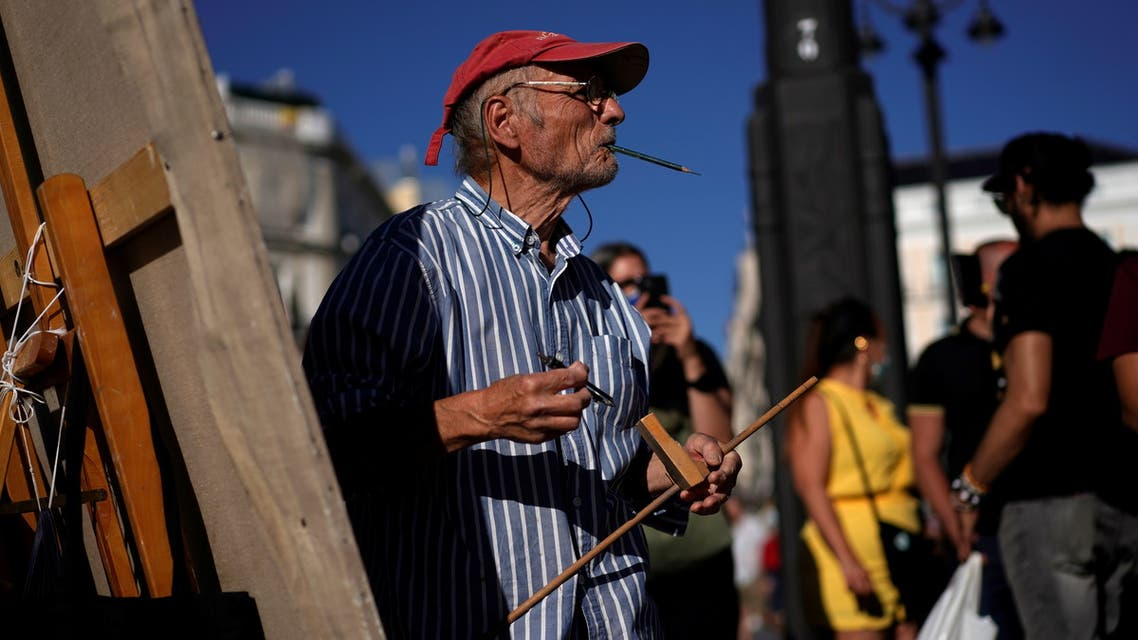 Spanish artist Antonio Lopez looks on during one of the sessions to paint the famous Puerta del Sol square in Madrid, Spain, August 4, 2021. Picture taken August 4, 2021. REUTERS/Juan Medina