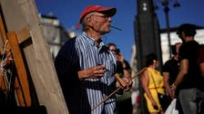Art lovers flock to Spain's Madrid square to watch artist Antonio Lopez paint