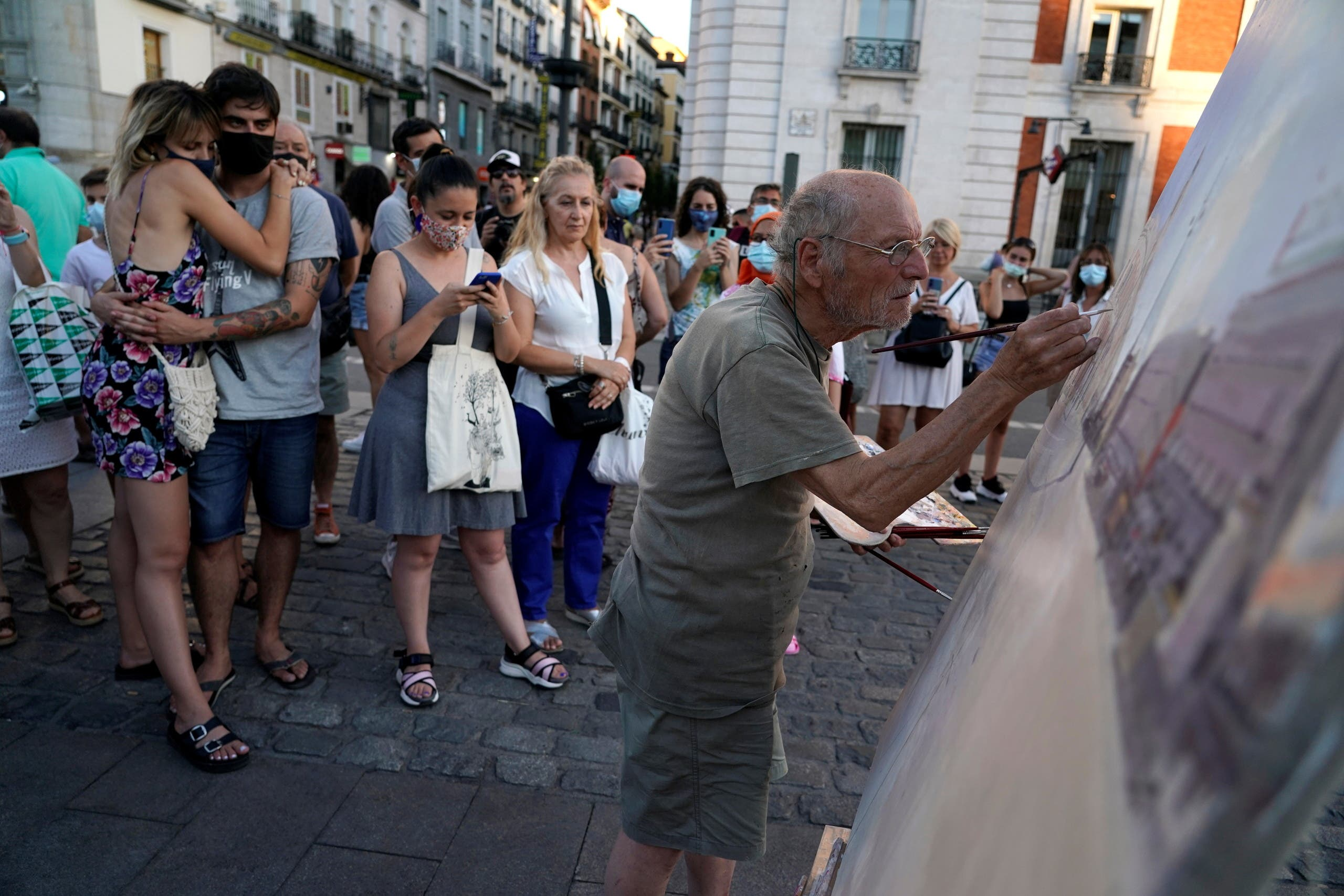 Spanish artist Antonio Lopez works during a session to paint the famous Puerta del Sol square in Madrid, Spain, August 5, 2021. Picture taken August 5, 2021. REUTERS/Juan Medina