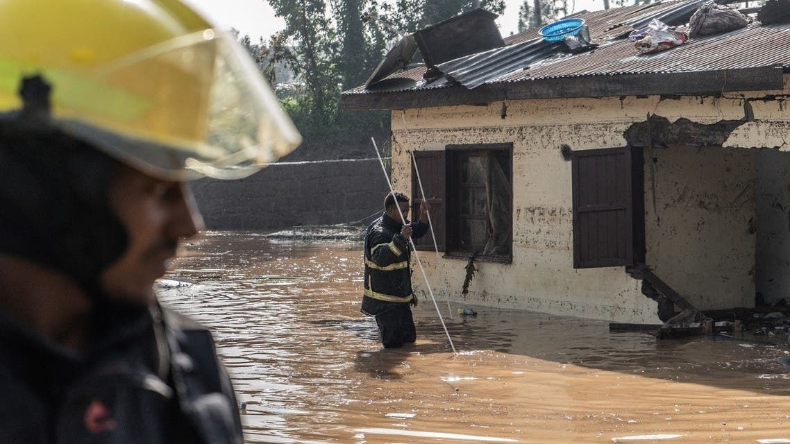 Fire fighters inspect damages caused by heavy rain which led to flood resident homes in Addis Ababa, Ethiopia, on August 18, 2021. (Amanuel Sileshi/AFP)