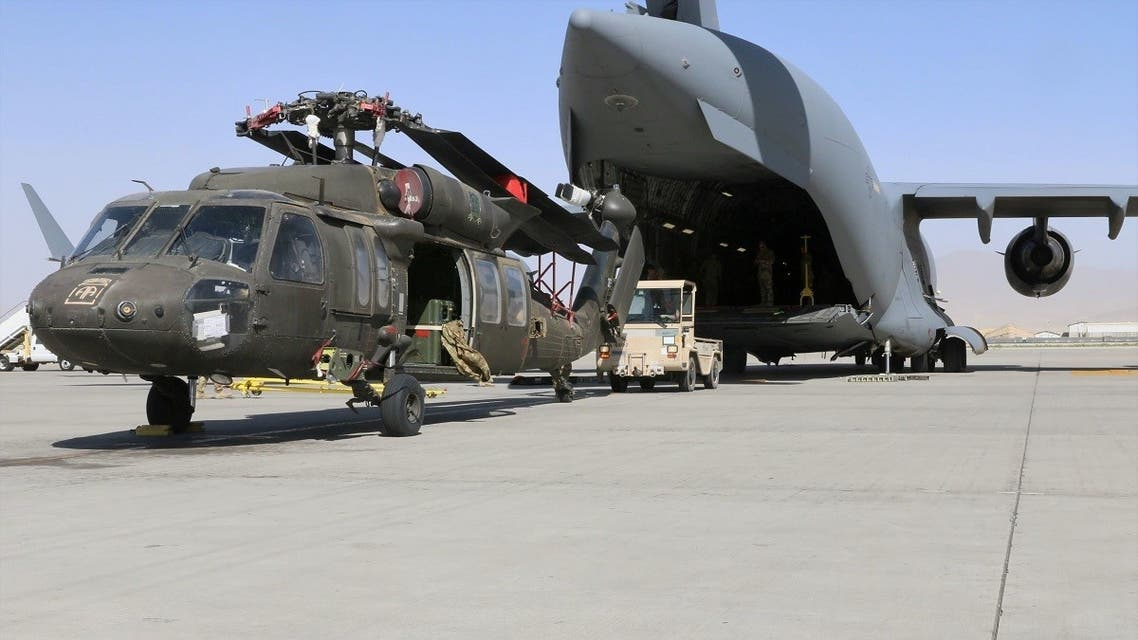 Aerial porters work with maintainers to load a UH-60L Blackhawk helicopter into a US Air Force C-17 Globemaster III during the withdrawal of American forces in Afghanistan, June 16, 2021. (US Army/Sgt. 1st Class Corey Vandiver/Handout via Reuters)
