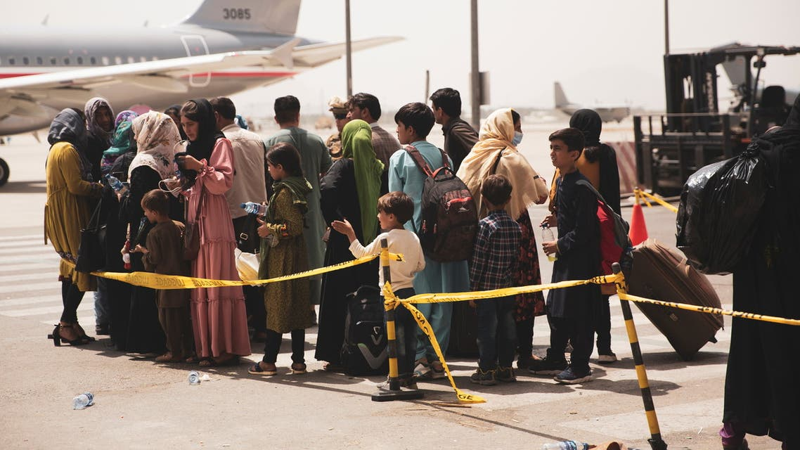 Civilians prepare to board a plane during an evacuation at Hamid Karzai International Airport, Kabul, Afghanistan August 18, 2021. (Reuters)