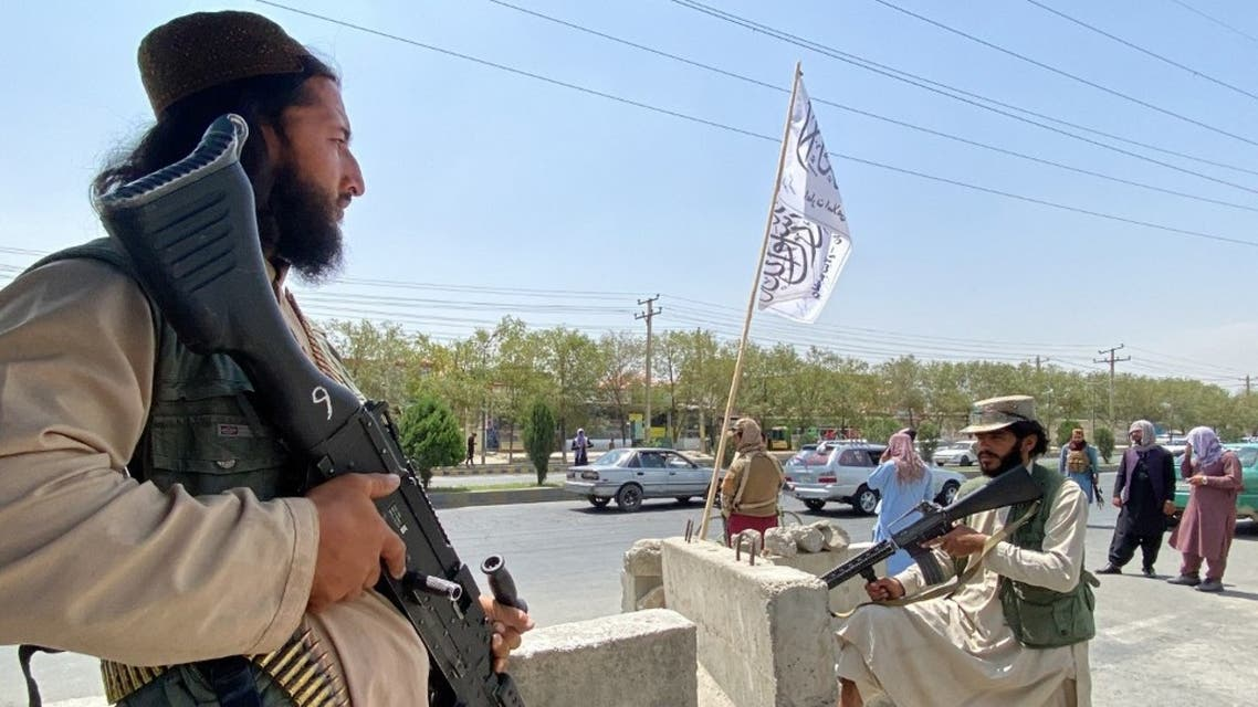 Taliban fighters stand guard at an entrance gate outside the Interior Ministry in Kabul on August 17, 2021. (AFP)