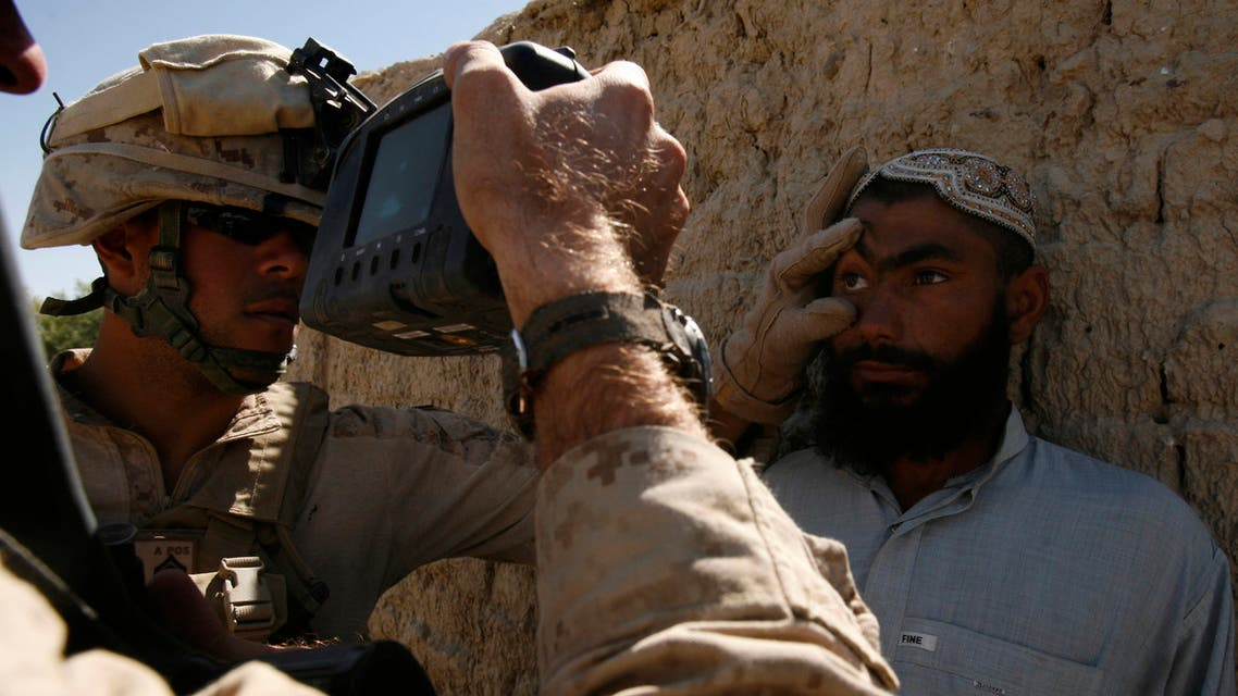 U.S. Marines use Hide's camera to scan the fingerprints and iris of an Afghani villager during a patrol to collect information on villagers close to Barcha village in Helmand province, October 11, 2009. (Reuters)