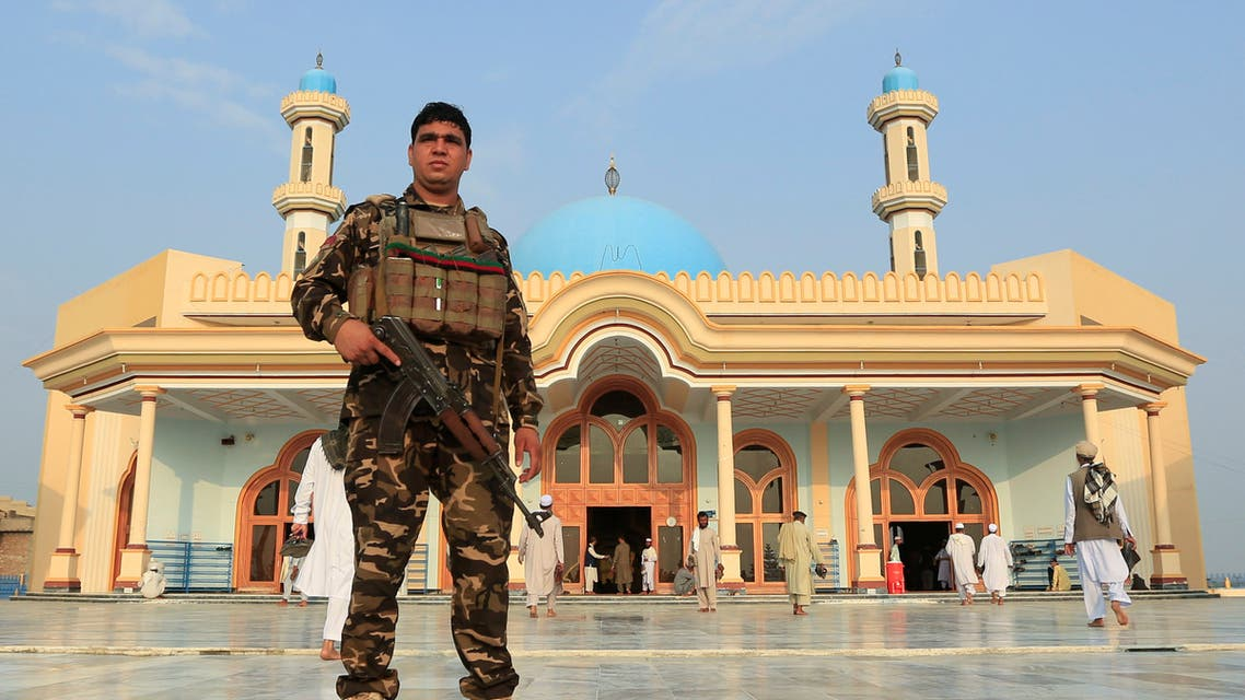 An Afghan security force stands guard outside a mosque before prayers during the Muslim festival of Eid al-Adha, amid the spread of the coronavirus disease (COVID-19), in Jalalabad, Afghanistan July 31, 2020. (Reuters)