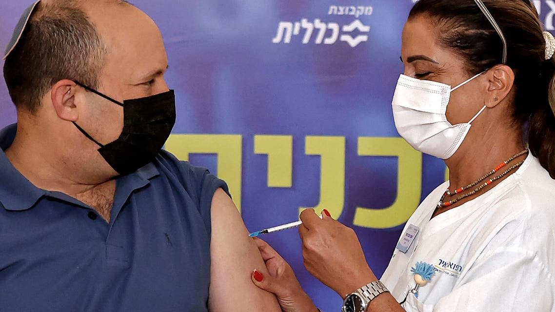 Israeli Prime Minister Naftali Bennett receives a booster shot of vaccine against the coronavirus, at Meir Medical Center in the central Israeli city of Kfar Saba, on August 20, 2021. Bennett received a coronavirus vaccine booster shot today, as the country began administering them to people aged 40 and over amid a spike in infections. (File photo: AFP)