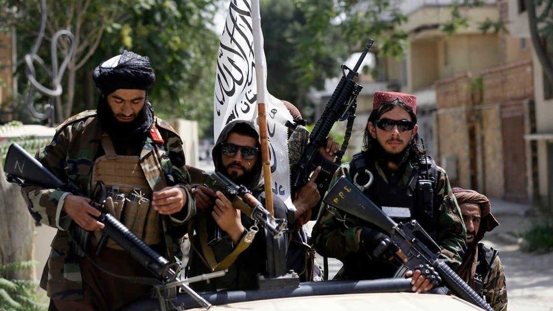 Taliban fighters display their flag on patrol in Kabul, Afghanistan, on August 19, 2021. (AP)