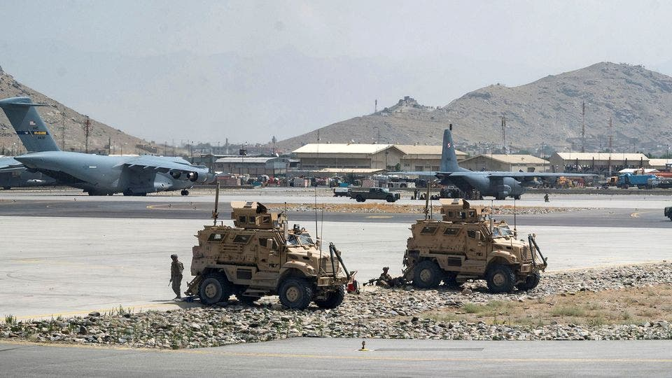 US Army soldiers assigned to the 82nd Airborne Division patrol Hamid Karzai International Airport in Kabul, Afghanistan August 17, 2021. (Reuters)