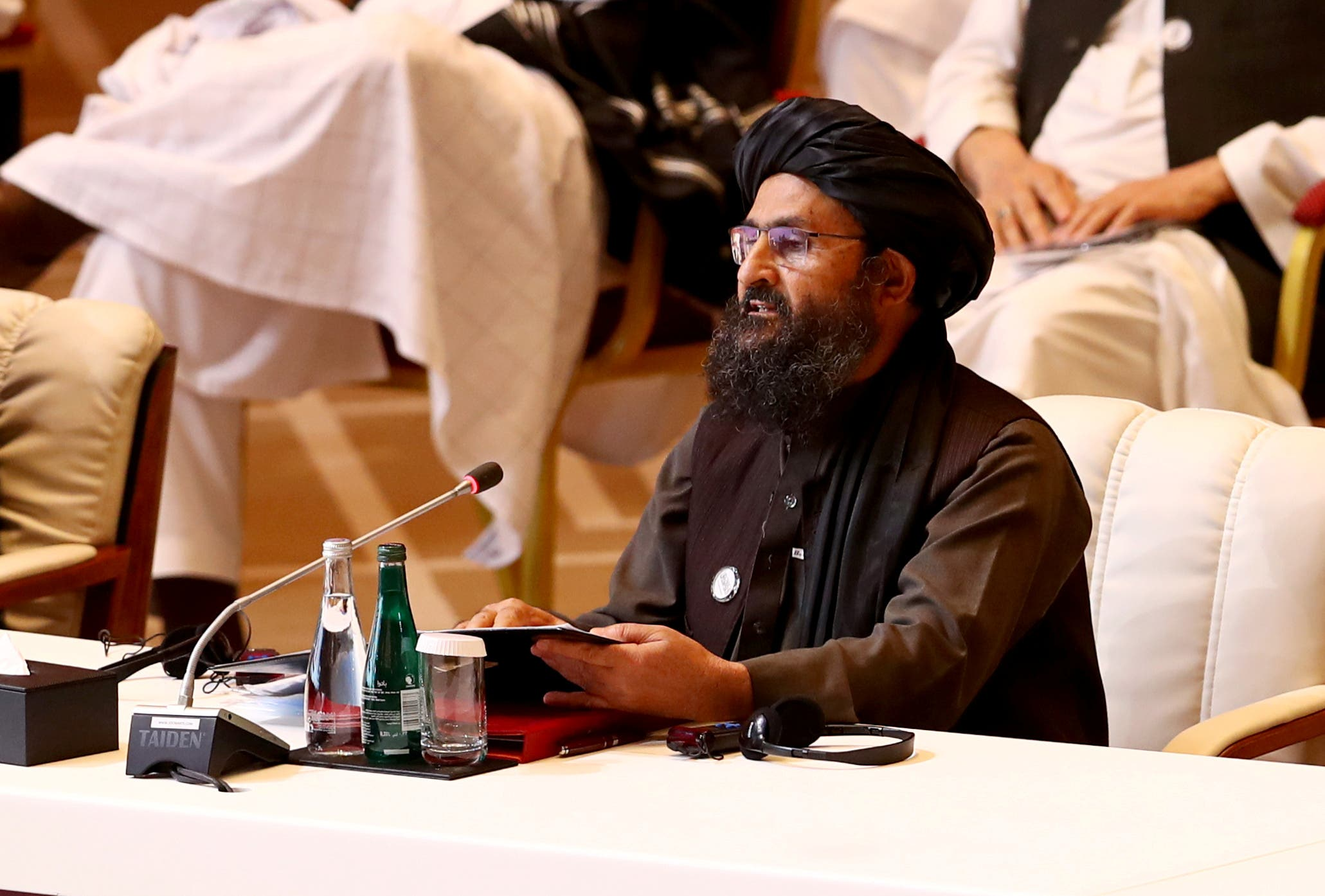 Abdul Ghani Baradar, the leader of the Taliban delegation, speaks during talks between the Afghan government and Taliban insurgents in Doha, Qatar September 12, 2020.(Reuters)