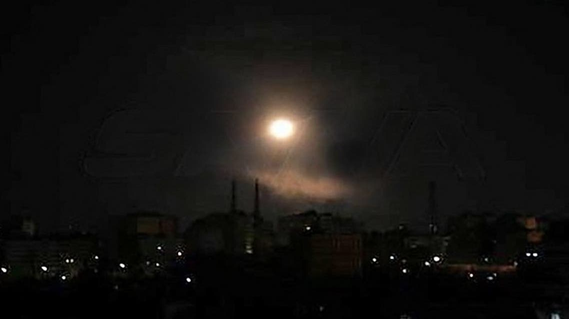 A handout picture released by the official Syrian Arab News Agency (SANA) on August 20, 2021 shows a light spot over the capital Damascus late on August 19, 2021. (AFP)