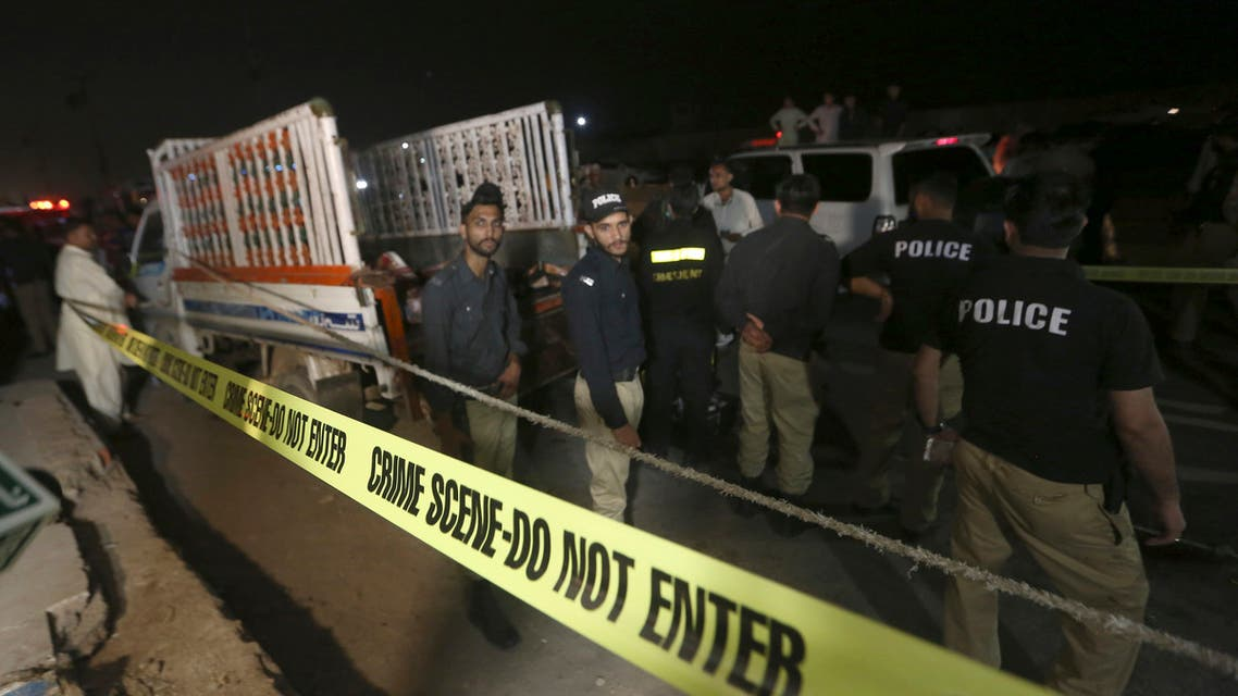 Police officers examine a truck at the site of an explosion, in Karachi, Pakistan, Saturday, Aug. 14, 2021. (File photo: AP)