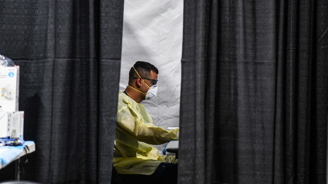 File photo of health care workers inside the Regeneron Clinic at a monoclonal antibody treatment site in Pembroke Pines, Florida, on August 19, 2021. (AFP)