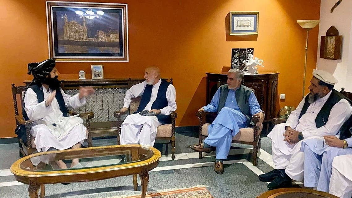 Former Afghan President Hamid Karzai, accompanied by the old government's main peace envoy, Abdullah Abdullah, sits for talks with members of the Taliban delegation in this undated handout uploaded August 19, 2021. (Reuters)