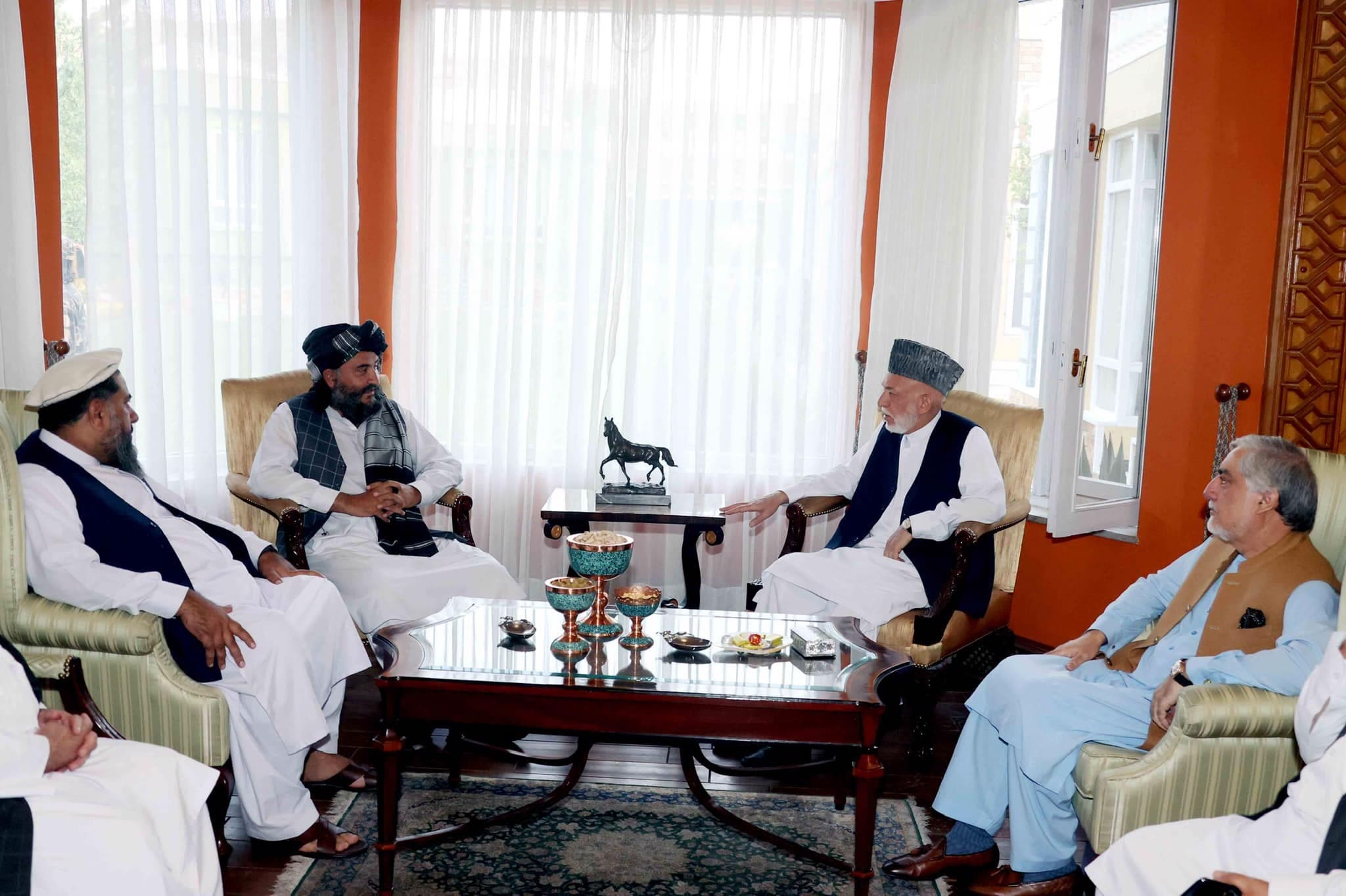 Former Afghan President Hamid Karzai and the chairman of the High Council for National Reconciliation, Abdullah Abdullah, meet with Abdul Rahman Mansour, the acting governor of Kabul for the Taliban. (Twitter/DrabdullahCE)