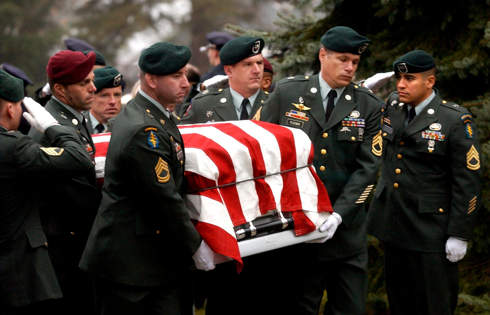 US Army Special Forces soldiers carry the casket containing the body of Sergeant First Class Daniel Petithory at his funeral at St. Mary of the Assumption Church in Petithory's hometown of Cheshire, Massachusetts December 13, 2001. Petithory was killed December 5 when an American bomb landed about 100 yards from their position north of Kandahar, Afghanistan. (Reuters)