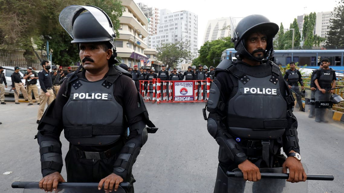 Police officers in riot gear stand guard on a road leading towards the U.S. consulate, in Karachi, Pakistan May 21, 2021. (Reuters)