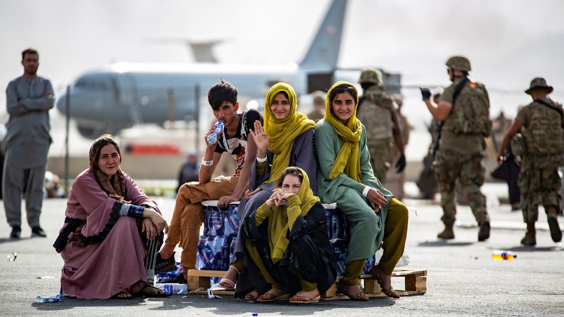 Evacuee children wait for the next flight after being manifested at Hamid Karzai International Airport, in Kabul, Afghanistan, August 19, 2021. (Reuters)