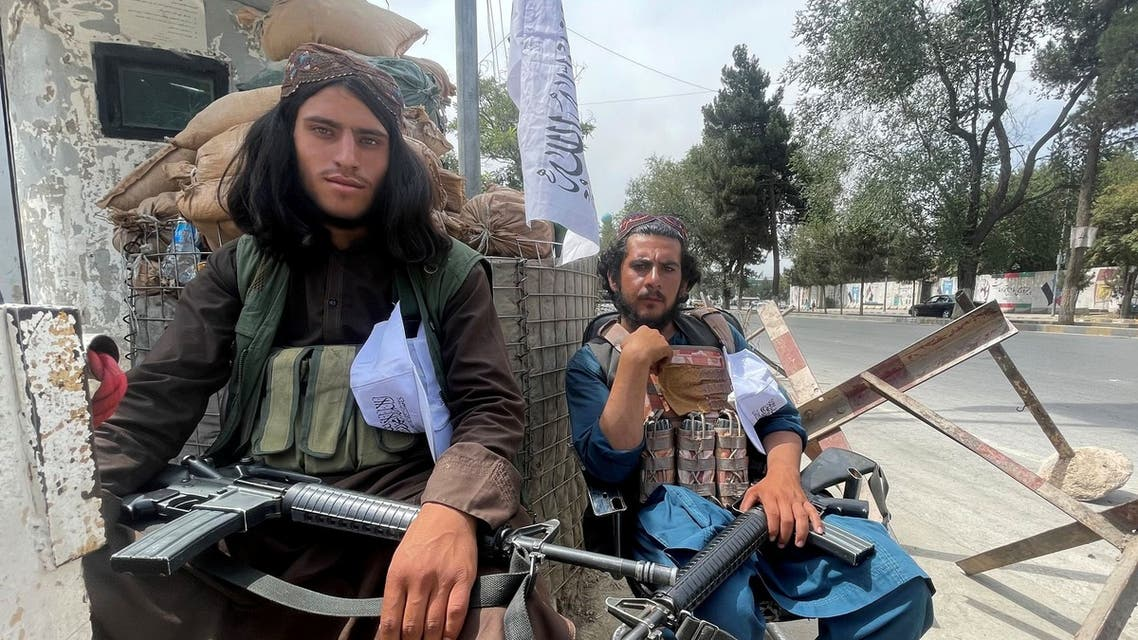Members of Taliban forces sit at a checkpost in Kabul, Afghanistan August 17, 2021. REUTERS/Stringer NO RESALES. NO ARCHIVES TPX IMAGES OF THE DAY