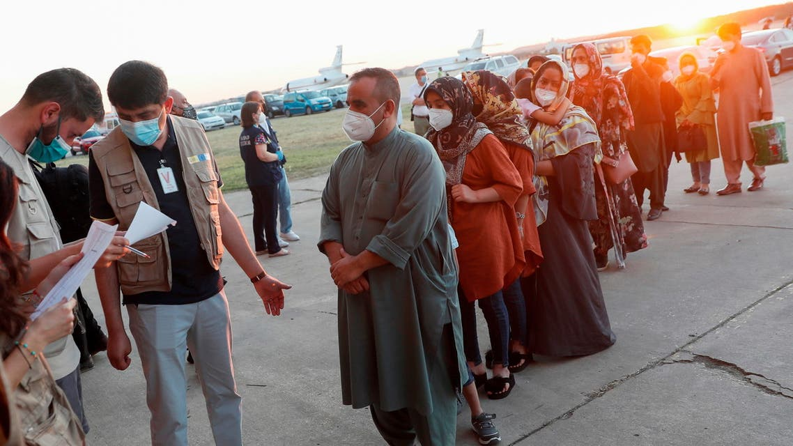 Afghan citizens who were evacuated from Kabul arrive at Torrejon Air Base in Torrejon de Ardoz, outside Madrid, Spain, August 20, 2021. (Reuters)