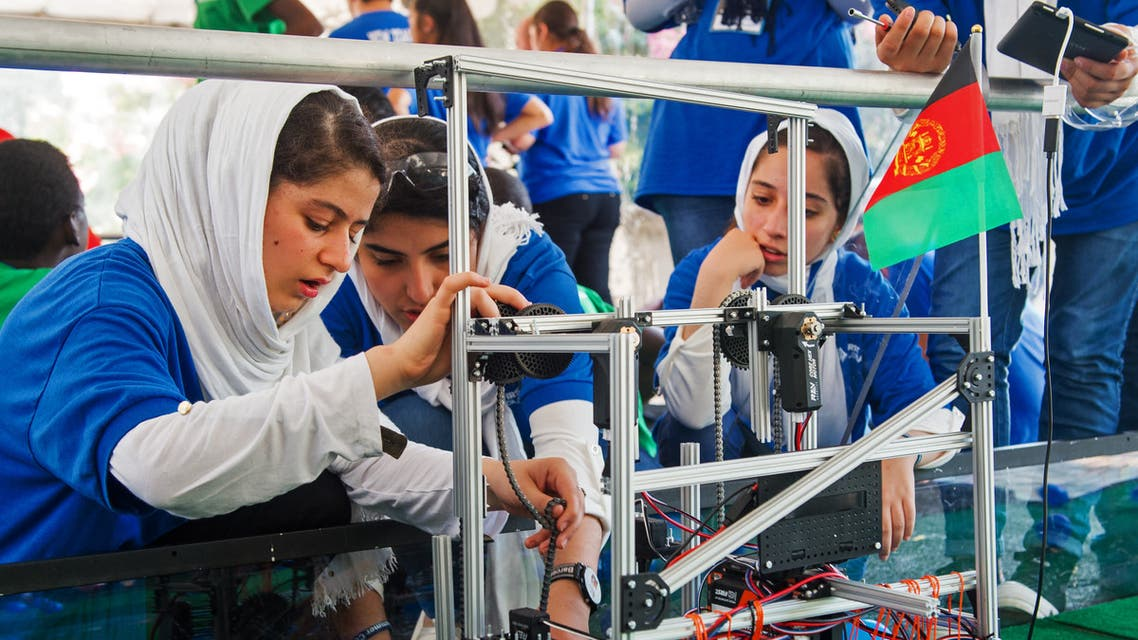 Members of the Afghan all-girls robotics team work with their robot in the practice area on July 17, 2017, between 2017 FIRST Global Challenge competitions at DAR Constitution Hall, in Washington, DC. (File photo: AFP)