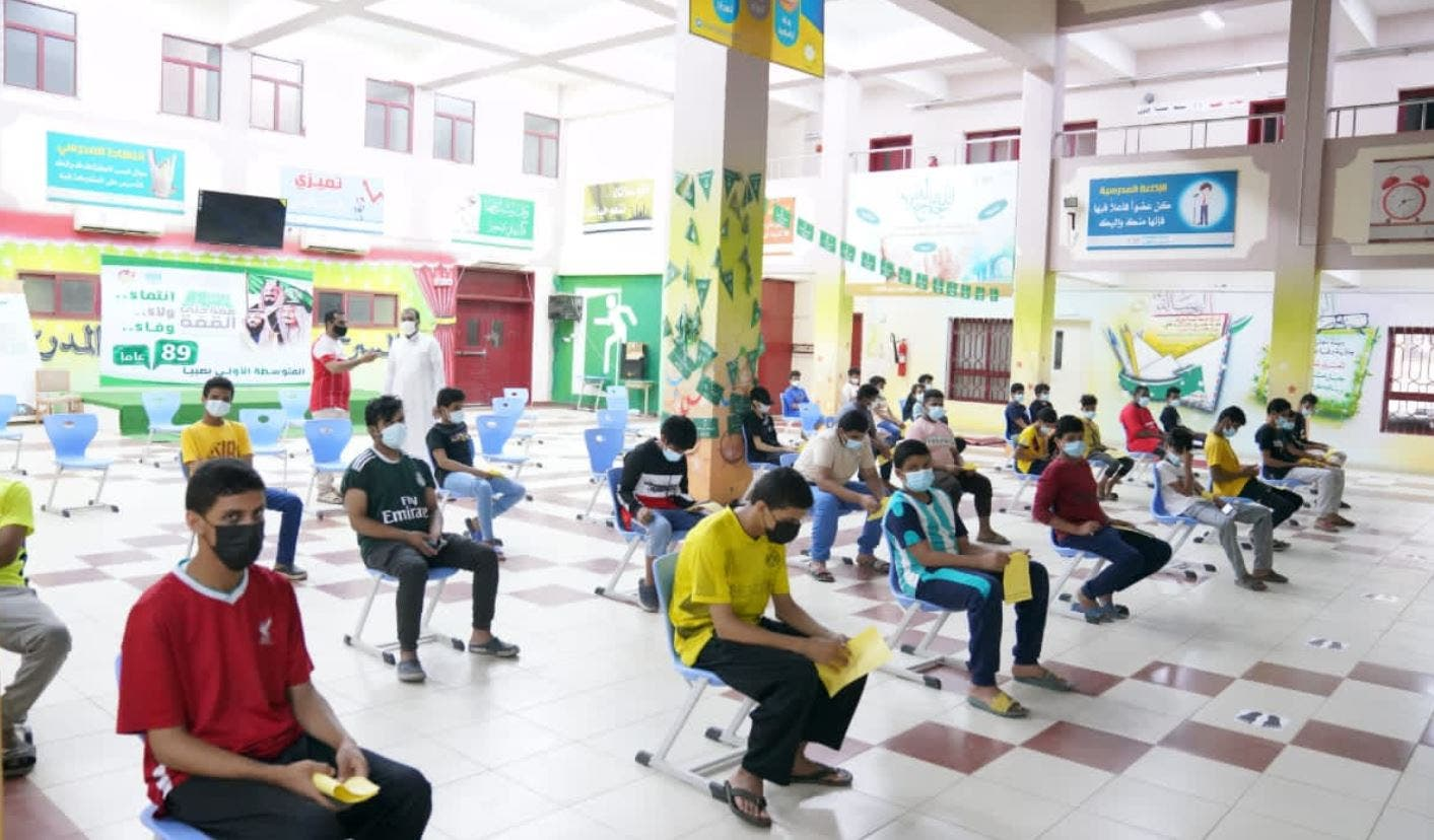 Young boys wait to receive their COVID-19 at an inoculation center in Saudi Arabia. (Photo Courtesy: Ministry of Education)