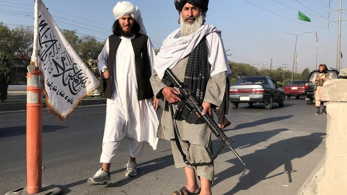 A Taliban fighter holding an M16 assault rifle stands outside the Interior Ministry in Kabul, Afghanistan, August 16, 2021. (Reuters)