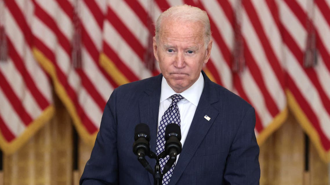WASHINGTON, DC - AUGUST 20: U.S. President Joe Biden gestures as delivers remarks on the U.S. military's ongoing evacuation efforts in Afghanistan from the East Room of the White House on August 20, 2021 in Washington, DC. The White House announced earlier that the U.S. has evacuated almost 14,000 people from Afghanistan since the end of July. Anna Moneymaker/Getty Images/AFP