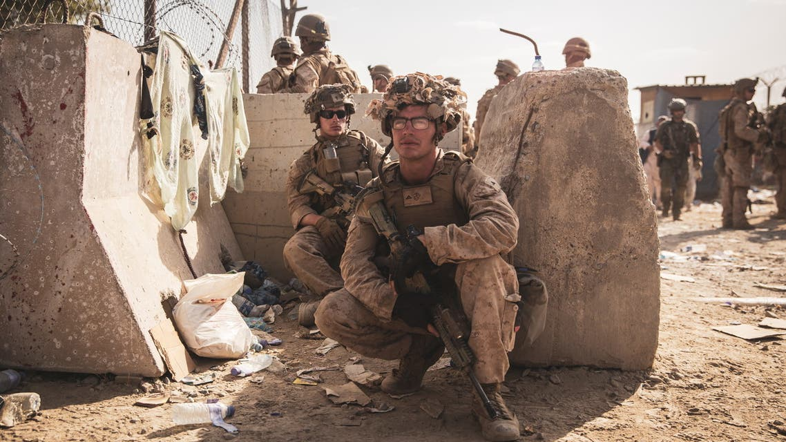 U.S. Marines take a moment to rest at an Evacuation Control Checkpoint during an evacuation at Hamid Karzai International Airport, Kabul, Afghanistan, August 20, 2021. Picture taken August 20, 2021. U.S. Marine Corps/Staff Sgt. Victor Mancilla/Handout via REUTERS THIS IMAGE HAS BEEN SUPPLIED BY A THIRD PARTY.